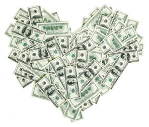 Heart shaped sign made with many 100 dollar banknotes